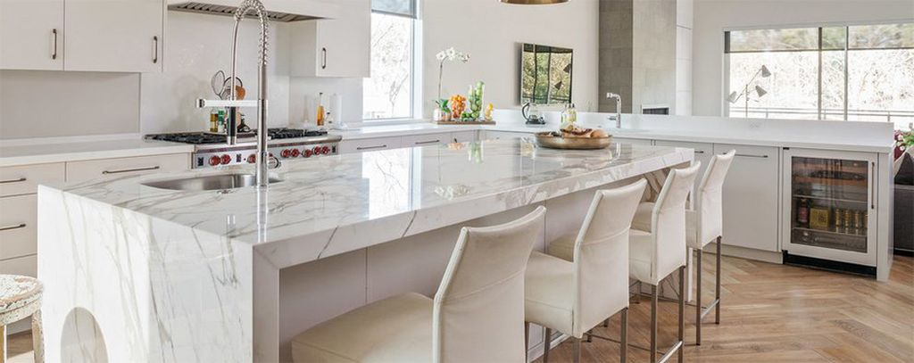 Perfect kitchen design combined with white granite countertops and white walls to perfect your modern kitchen