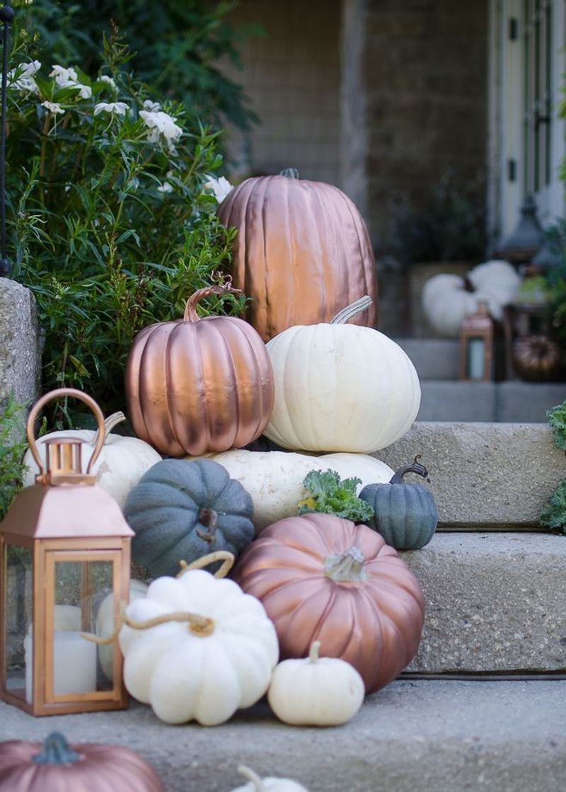 Pumpkins cascades of copper, off-white, and gray to combine with lanterns to brighten up your front stair in this fall