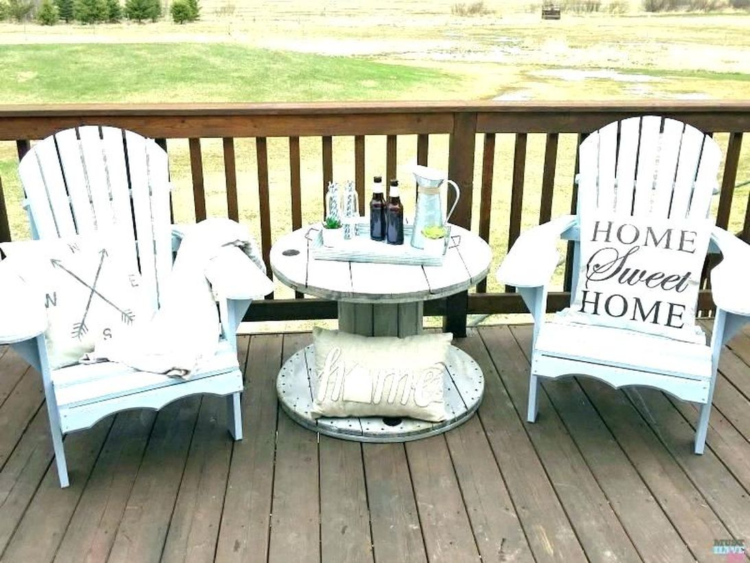 Simple farmhouse porch furniture with blue wooden chairs and small blue round table to create your front yard more comfortable