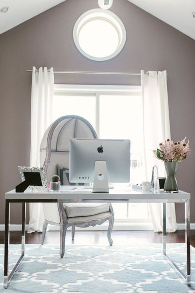 Sophisticated greige home office decoration combined with white curtain and a white chair to beautify your neutral office home