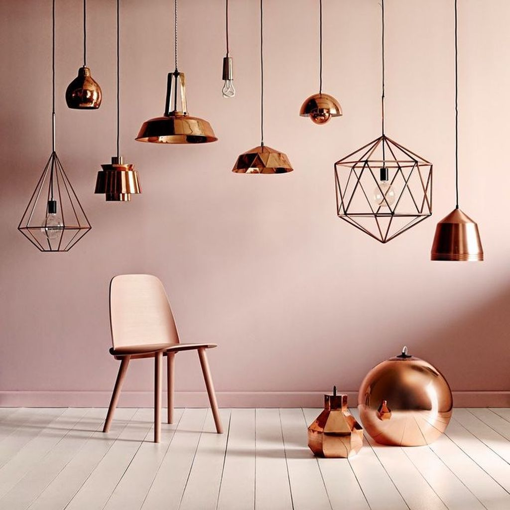 Special and captivating decorating feature with copper hanging lamps and a copper chair to perfect your decoration