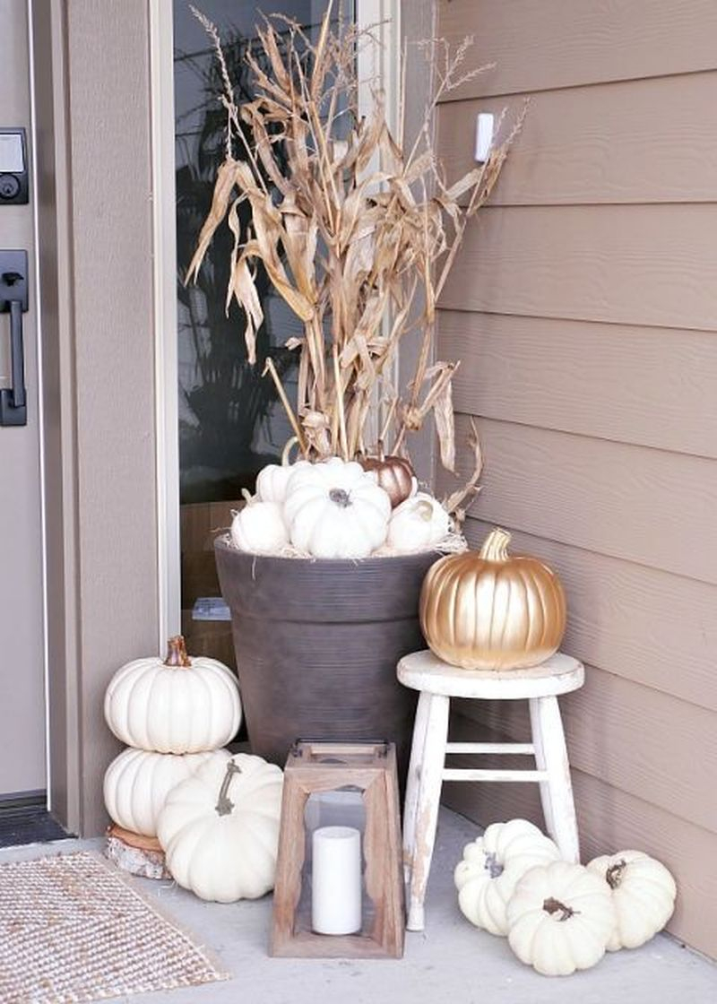 Use spray paint to coat pumpkins in white or metallic gold for a modern but simple scheme to complete your fall decoration