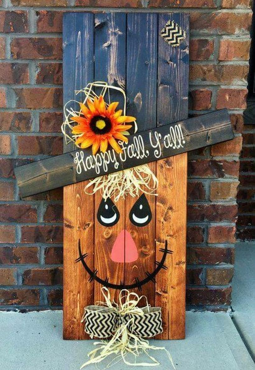 "An adorable scarecrow with the saying, ""happy fall y'all"" for your porch"