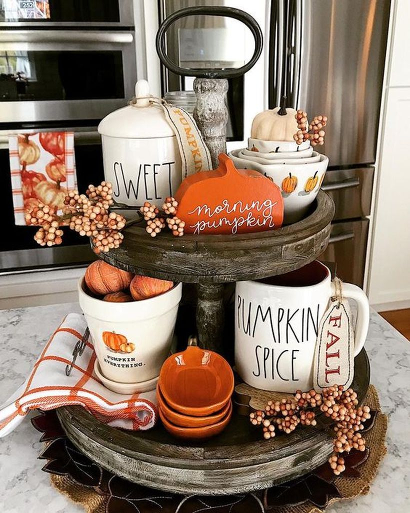 An inspired little pumpkin and white cup coffee using for centerpiece decoration in kitchen