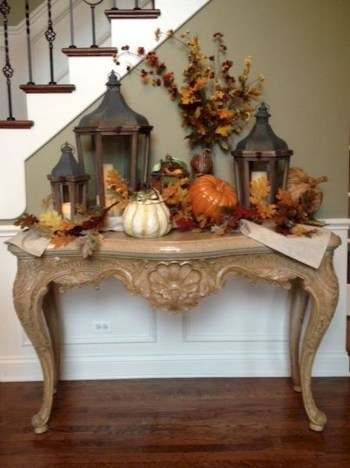 Decorating pumpkins and jars to create impression