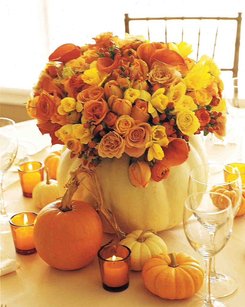 Orange and white pumpkin ornaments with flowers centerpiece ideas