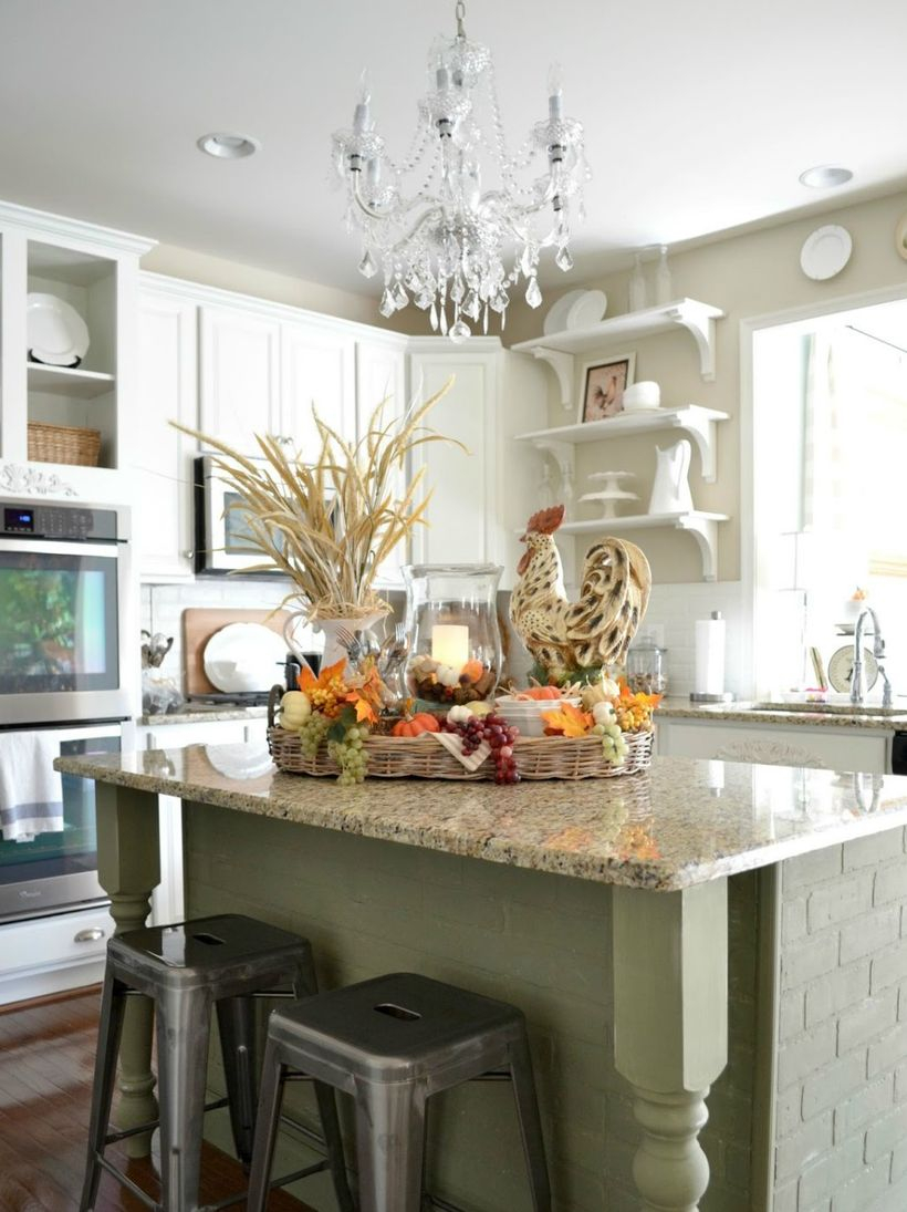 Pumpkin and house plants using for centerpiece decoration on kitchen island