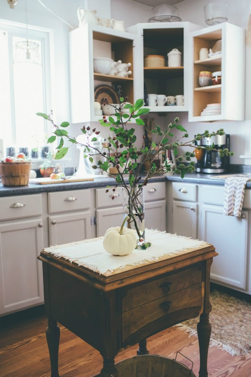 Simple farmhouse kitchen with white pumpkin decoration on wooden table you can try