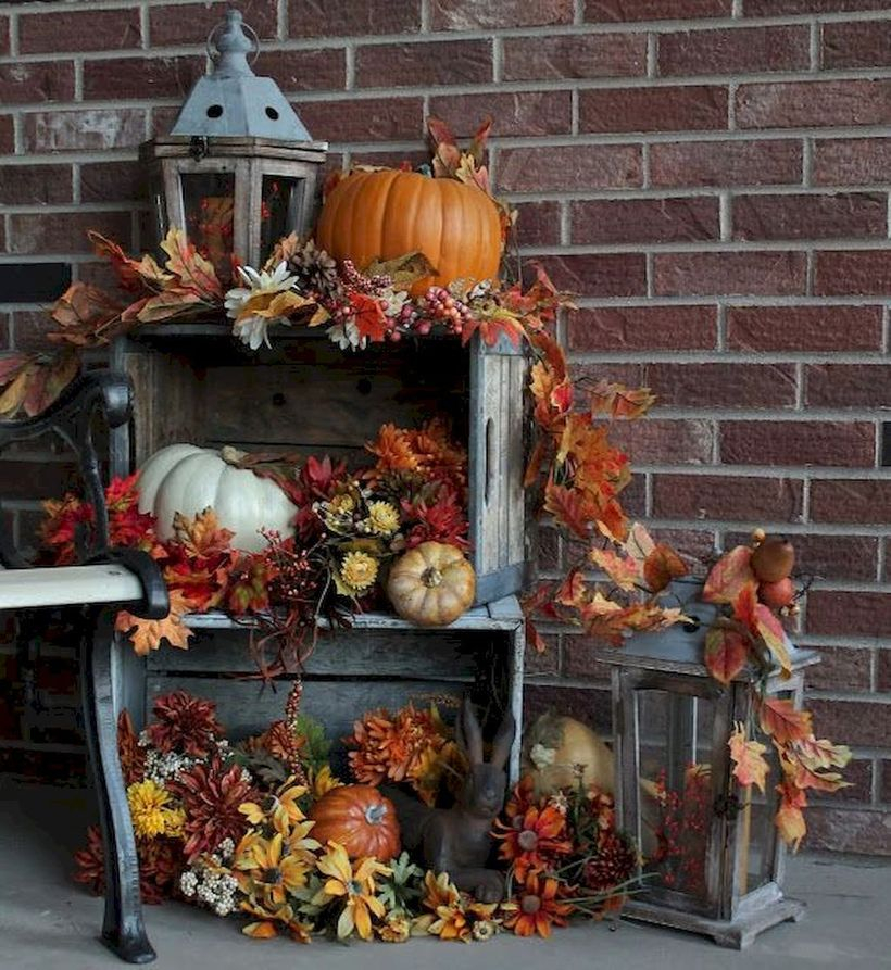 White and orange pumpkins and wooden box