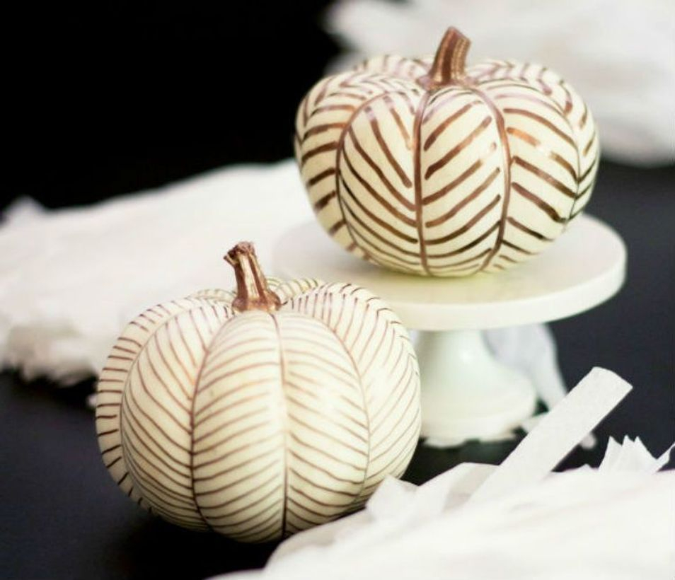 White pumpkins painted
