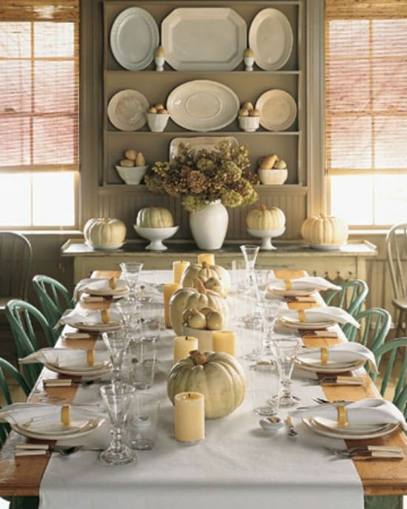 Wooden vertical rack and console table to store cutlery and pumpkins used white bowl for decorating your dining room
