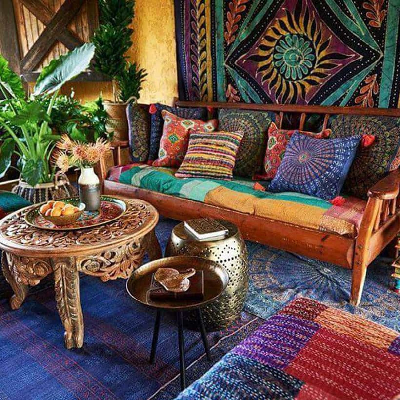 A fabulous furniture for bohemian home decorating with round wooden table for describing the bohemian lifestyle followed by most 19th century artists.