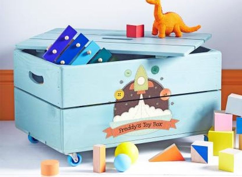 An awesome square storage for children toy with blue color, and small rocket image which can be taken anywhere