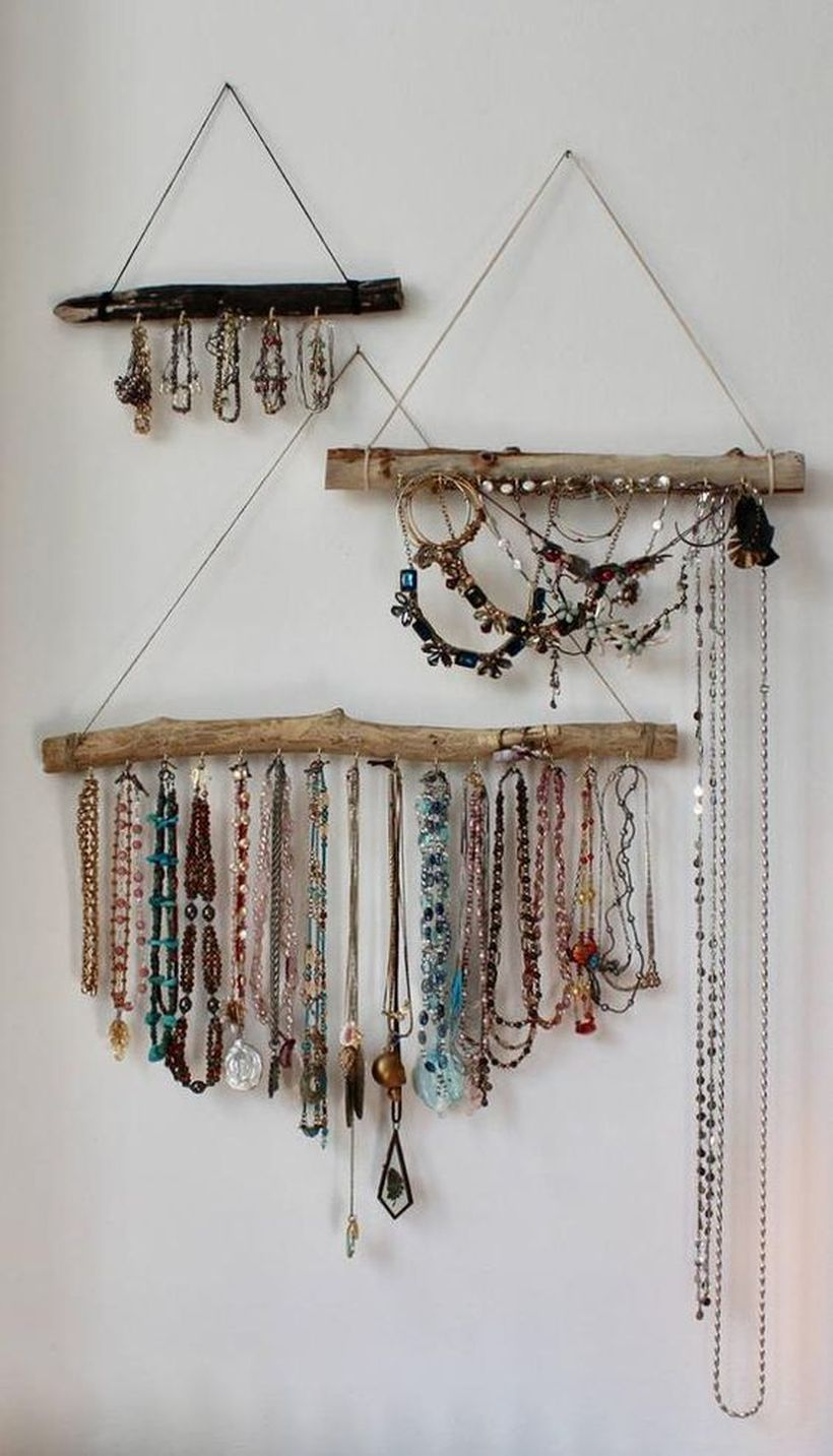 An adorable ornament for bohemian home decorating with driftwood jewelry organizer to decorate your walls to not be seen blank.