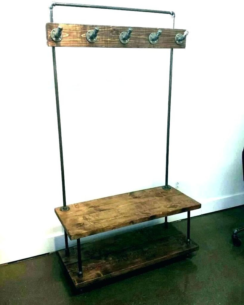 An amazing entryway design with simple bench combined with iron hooks to keep your bag and coat in your entryway