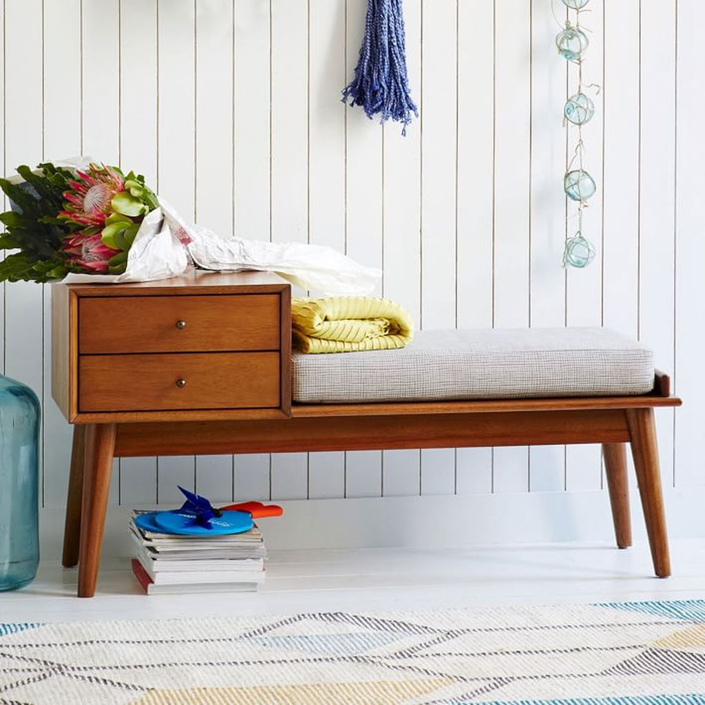 An amazing mid-century storage bench with wooden material to complete your entryways decor