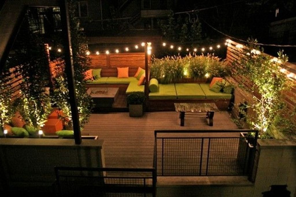 Beautiful small rooftop lighting by lights on edges and string light placed diagonally to beautify your rooftop garden