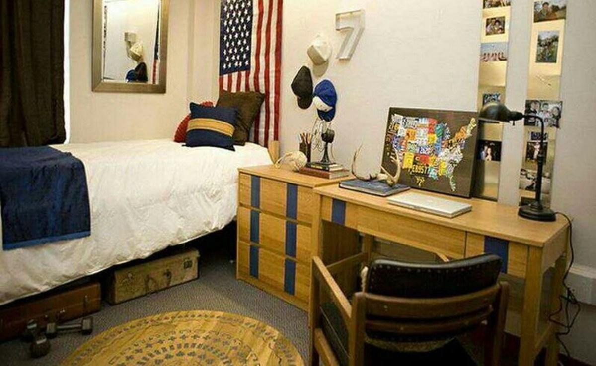 Charming boys room decoration with white mattresses, blue blankets, colorful cushions, and wooden desk chairs for learning to look good