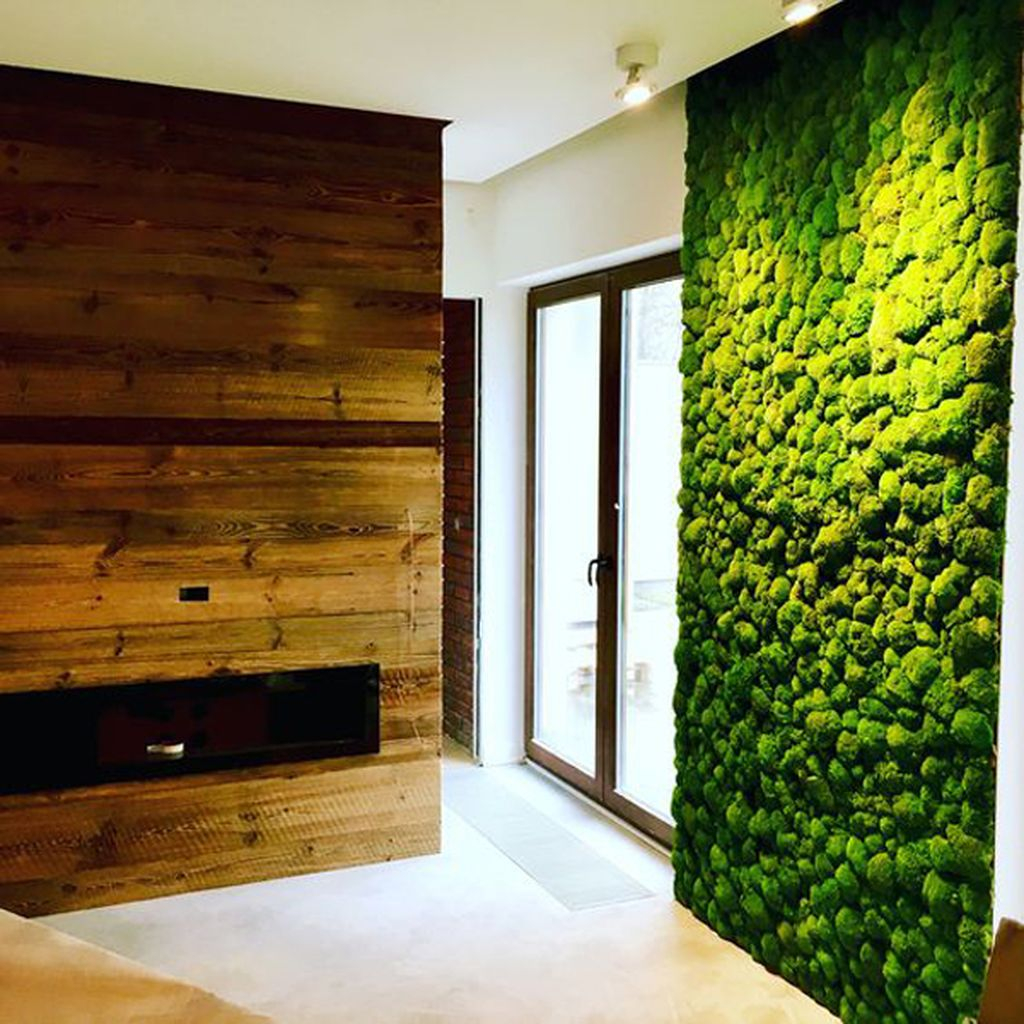 Comfortable modern bedroom decor with fireplace and moss wall in the wall to perfect in your bedroom decoration