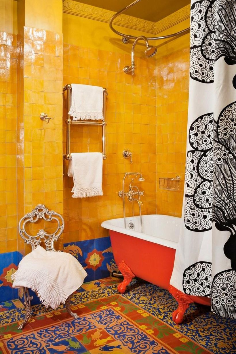 Cool boho bathroom decor with black patterned curtains in white, colorful tiles, and yellow walls to make it look smart