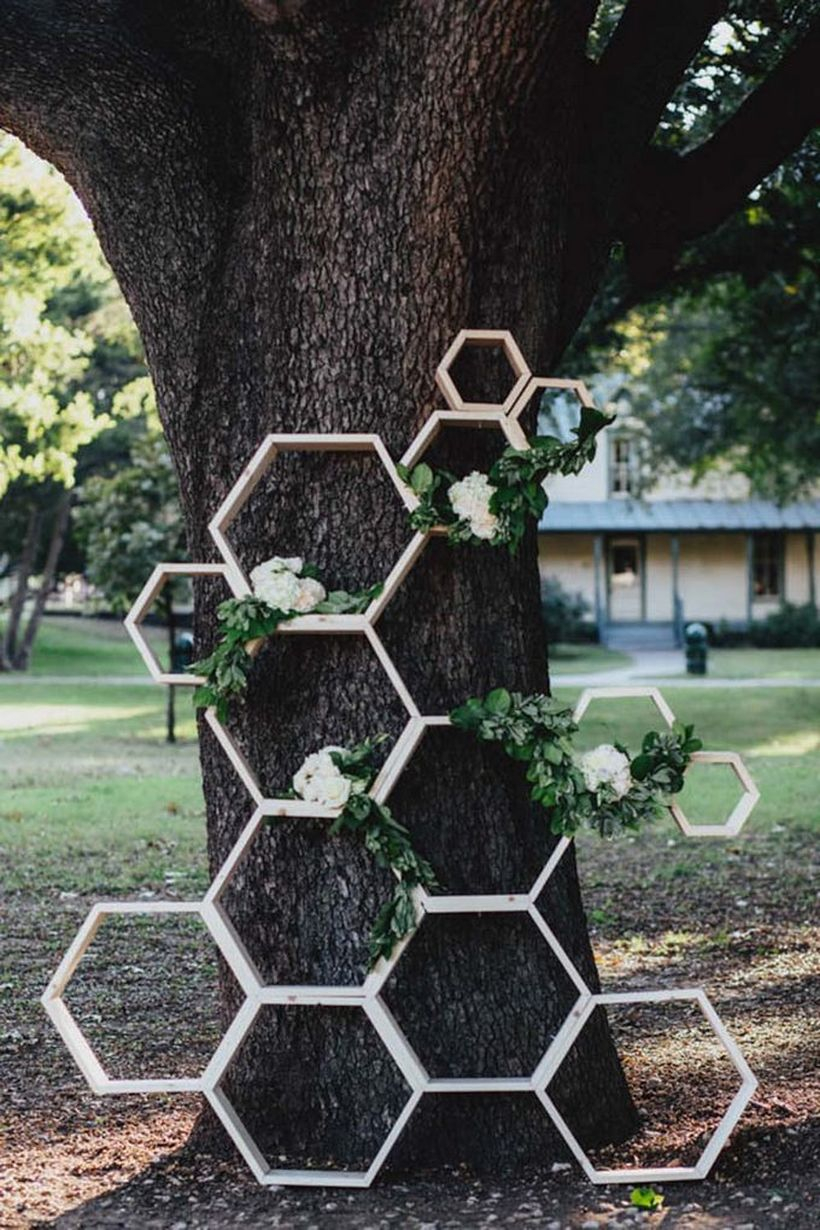 Creative industrial geometric wedding decoration with tiered hexagon rack to store white rose in outdoor