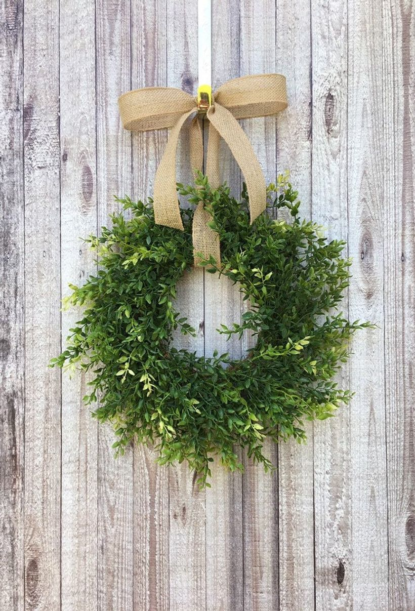 Farmhouse boxwood and burlap wreath with lush greenery and the rustic burlap bow to create rustic nuance