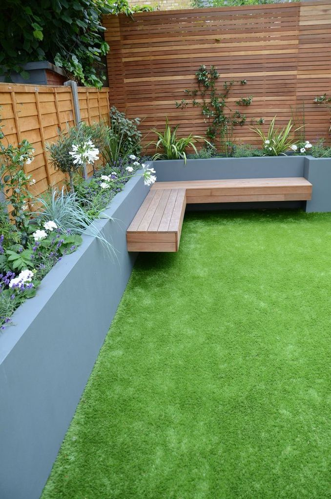 Garden design with wooden bench at the corner