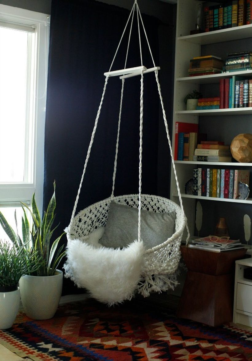 Hanging delicate white macrame chair.