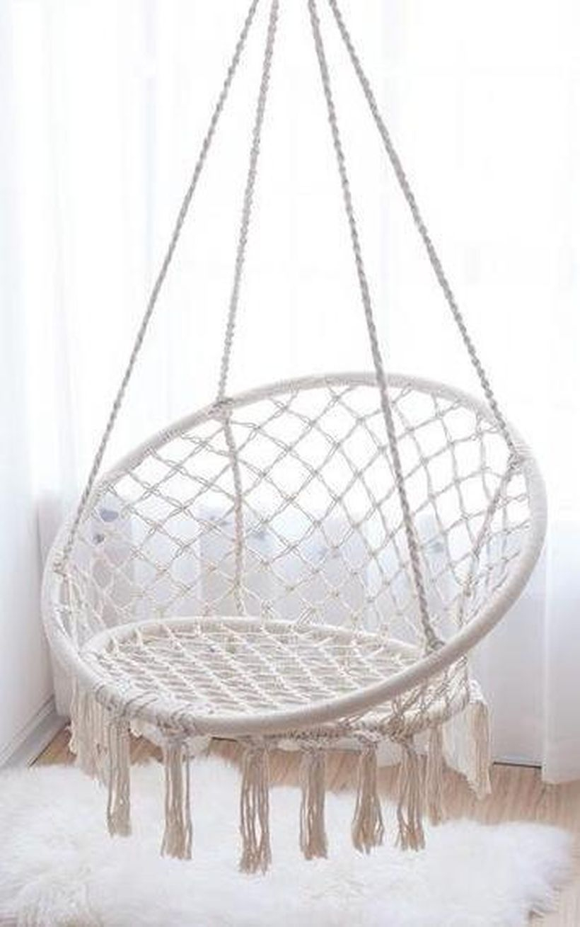 Modern hanging macrame chairs.