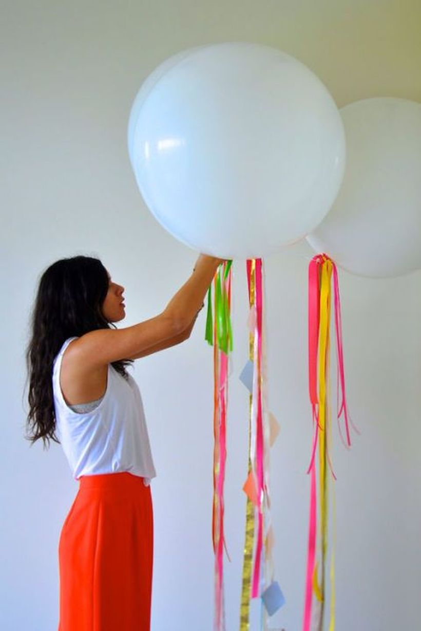 Ornament birthday party decoration with balloons then add ribbons to make it more interesting