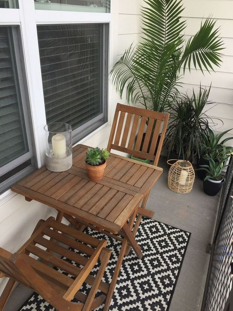 Patterned rug combined with wooden table and chair for balcony