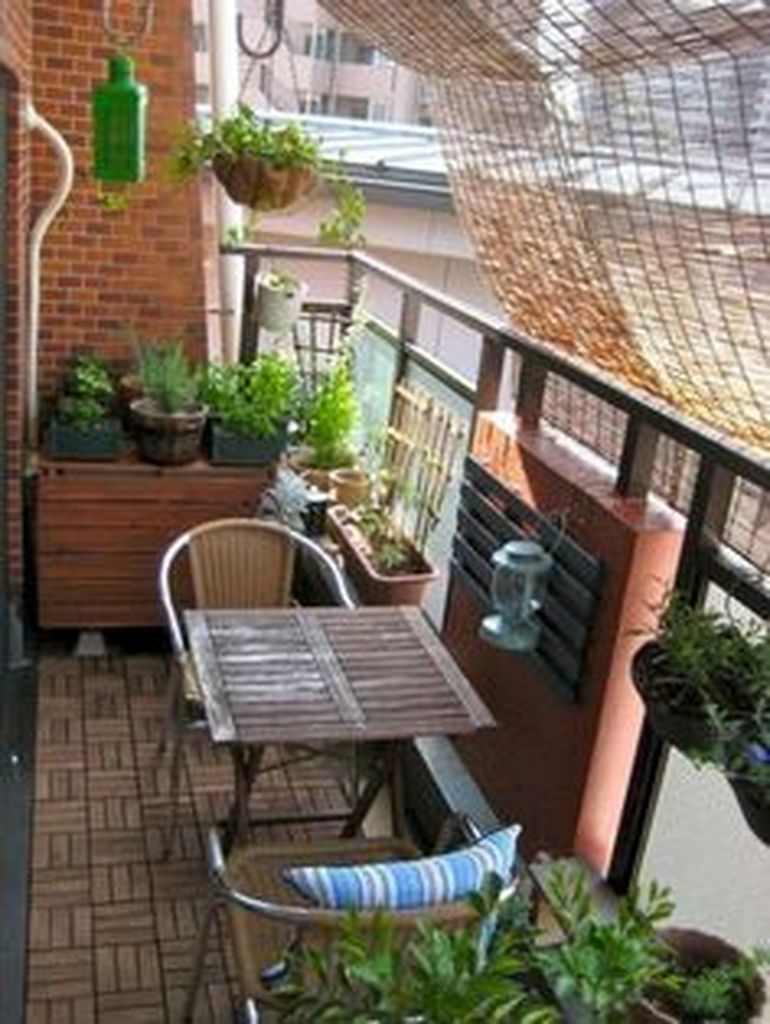 Rattan chairs combined with wooden table for small balcony