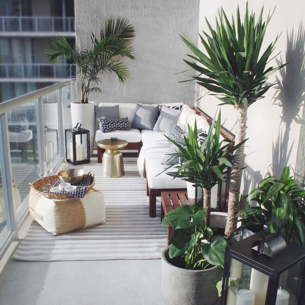 Small balcony with plants decoration and white shofas