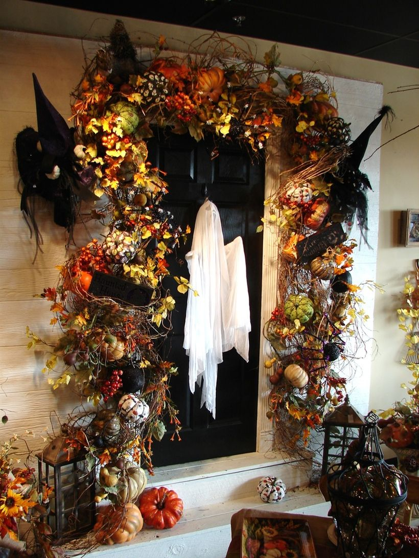 Spooky ghost halloween door decor.
