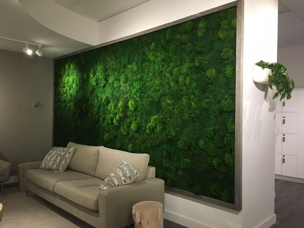 Unique modern living room design combined with white walls and moss wall to perfect your decoration