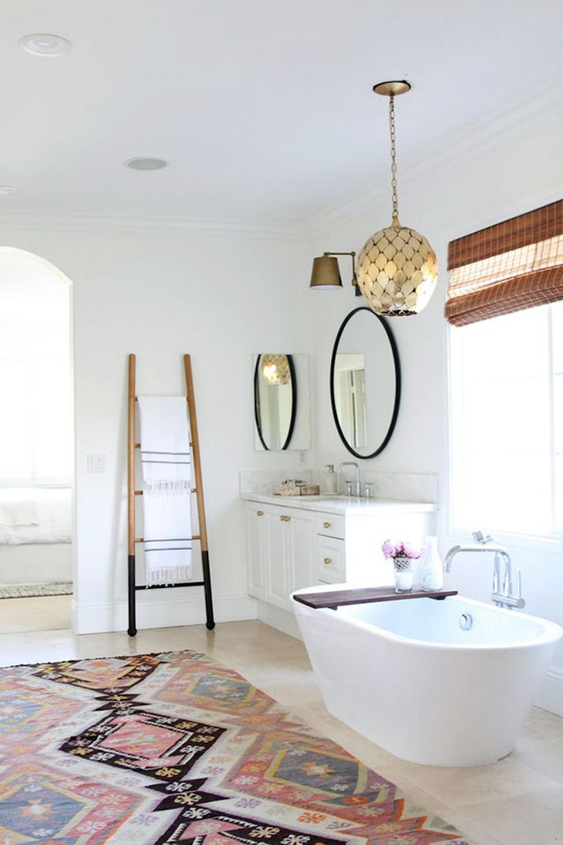 Wonderful boho bathroom decor with classic pattern tile, white bathtub and hanging plant to look awesome