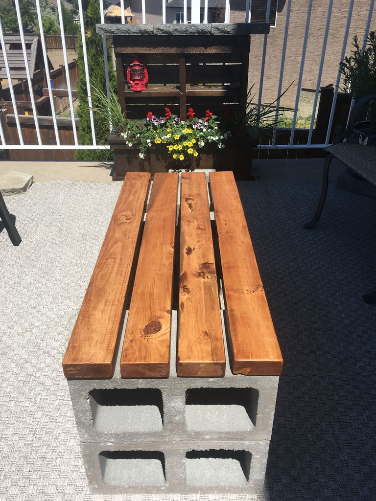 Wooden bench with brickwork stand