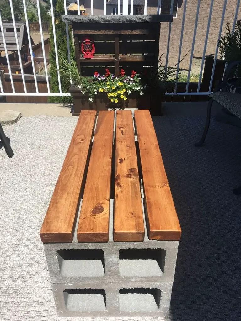 Wooden bench with brickwork stand