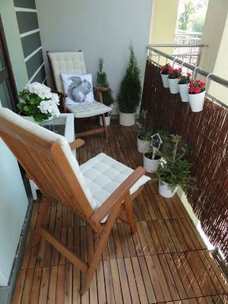 Wooden floor and wooden chair combined with plants decoration