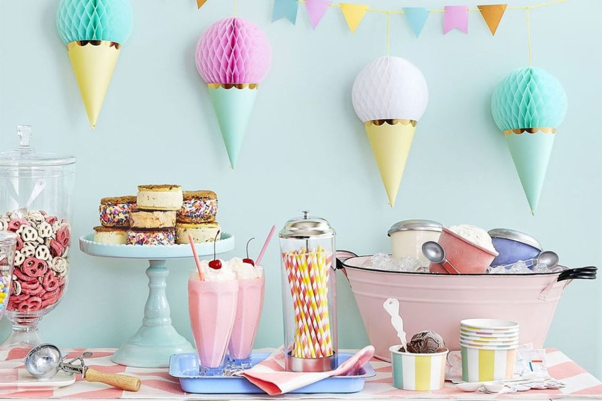 An interesting ornament birthday party decoration with ice cream garland pinned to the wall