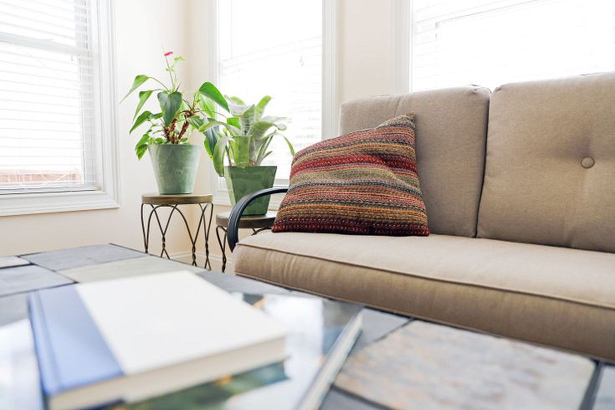 An interesting round table to put greenery for your living room