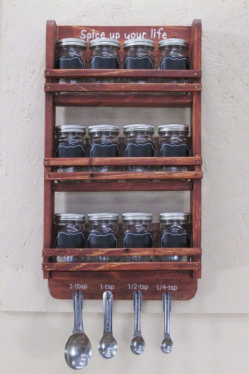 Brown wooden spice rack on the wall