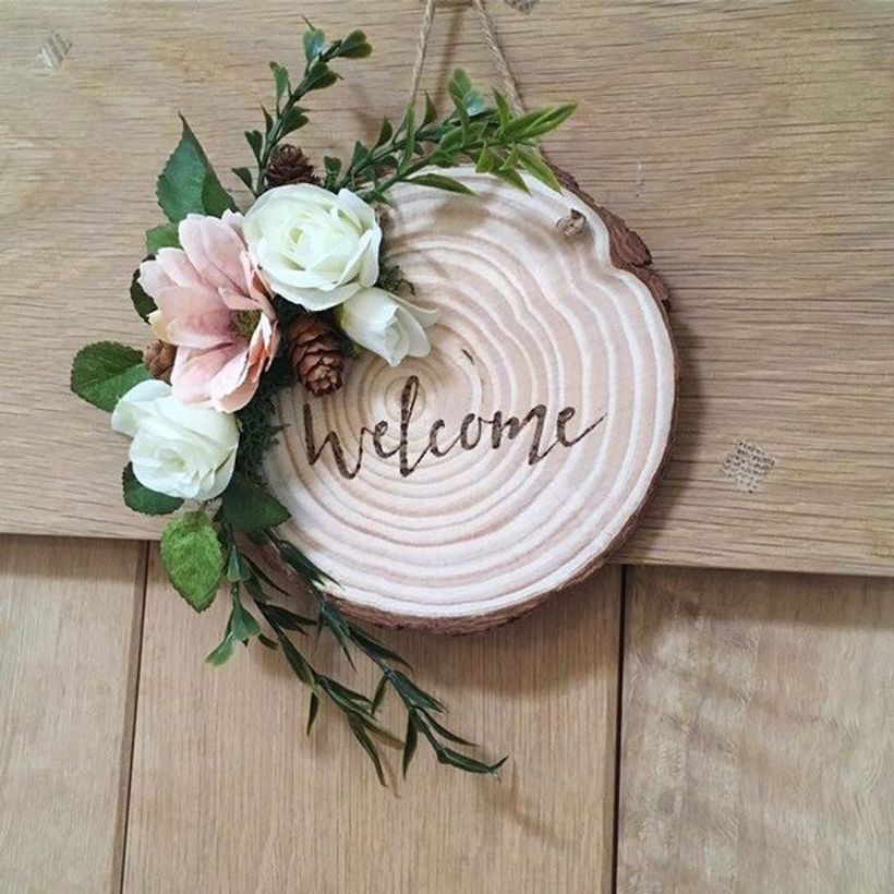 Creative front door decoration with wooden beam welcome front door sign and add white flowers