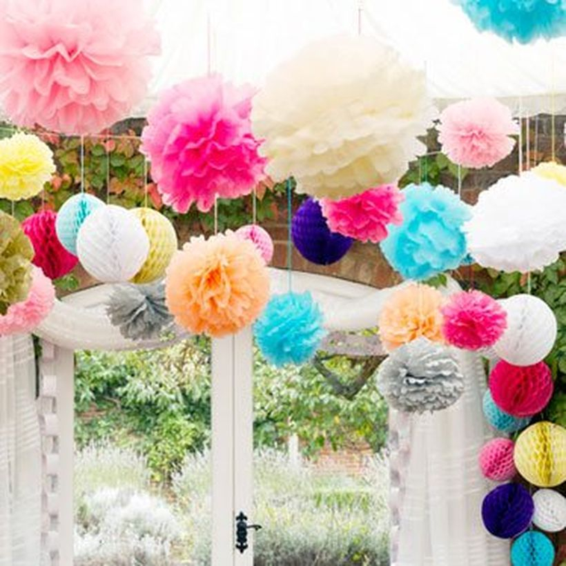 Creative paper carft with pom pom shape then hung to decorate a birthday party