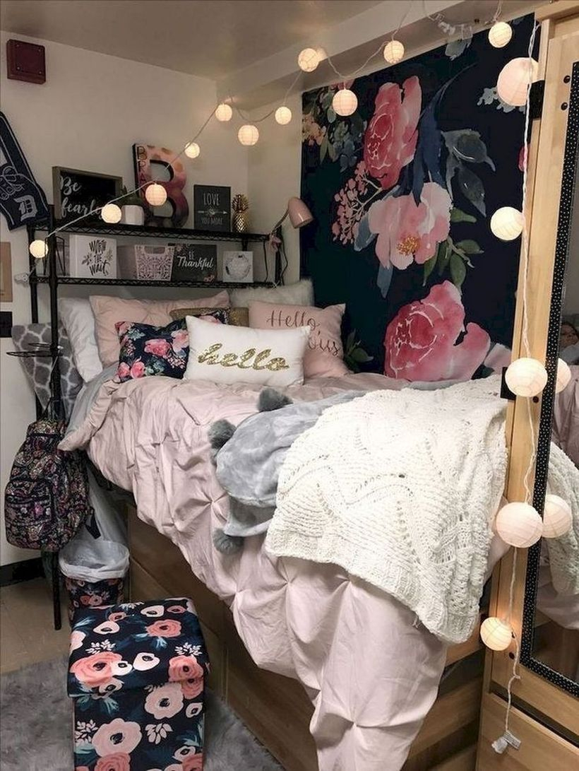 Fabulous girls room decoration with pink blankets, beige and white pillows, black storey storage above the bed, wooden storage under the bed and small round string lamps