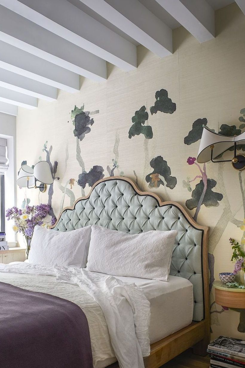 Farmhouse master bedroom with watercolor wallpaper to create beautify room