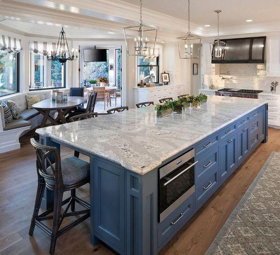 Long white countertop design on blue cabinet