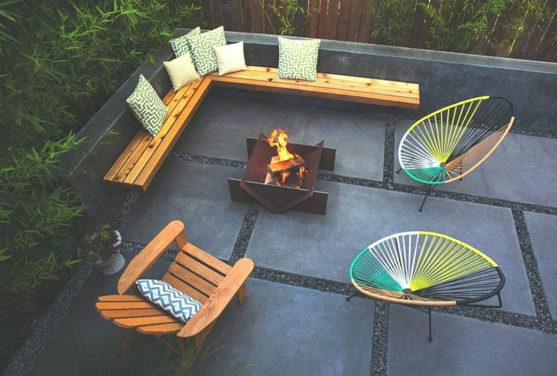 Modern fire pit with wooden pallet chair and iron chair