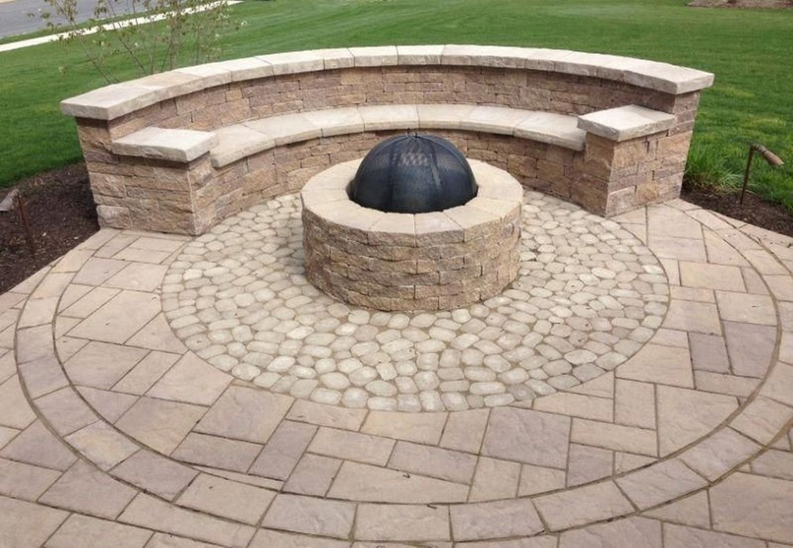 Outdoor curved fire pit with natural stone