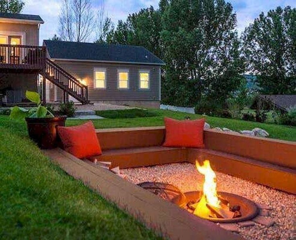 Portable fire pit and red sofa cushions
